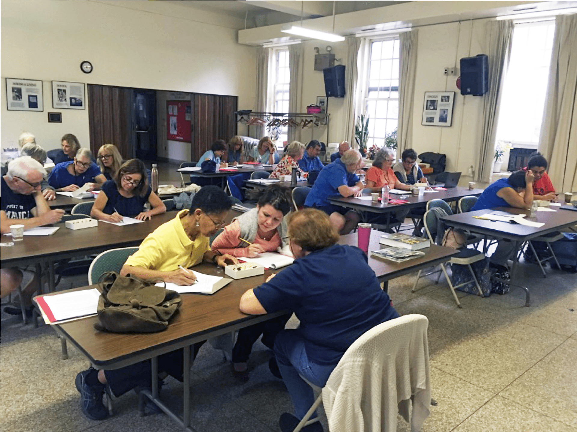 photo shows a classroom setting where master gardeners are learning to ideinty pests