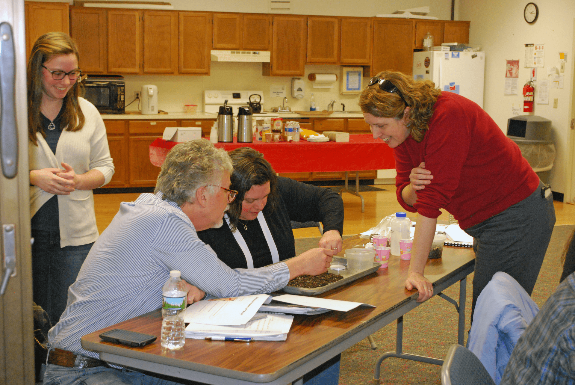 Joellen Lampman and Cornell Cooperative Extension staff and Master Gardeners examine soil and nematodes