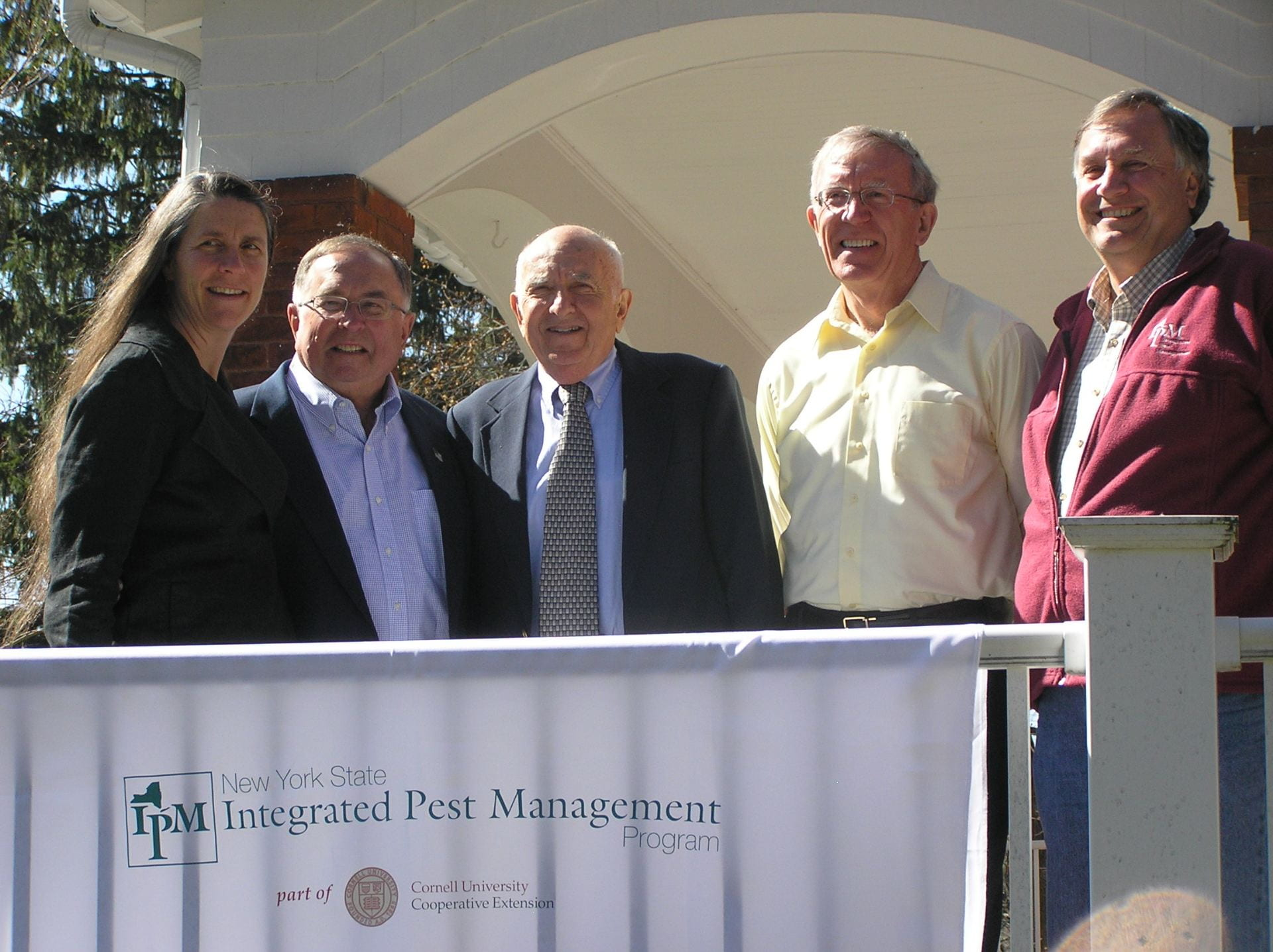 all the IPM directors in one photo on porch of IPM house