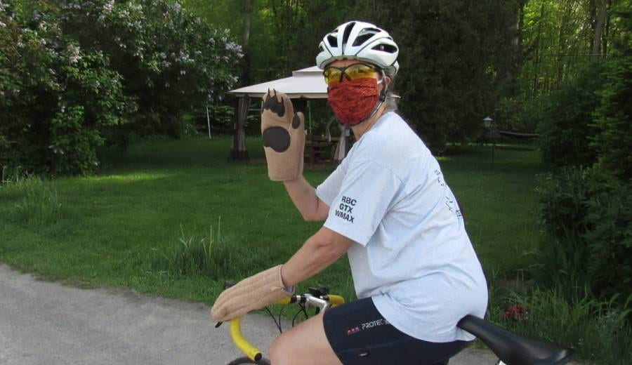 photo of Jen on a bike with mask and bear gloves