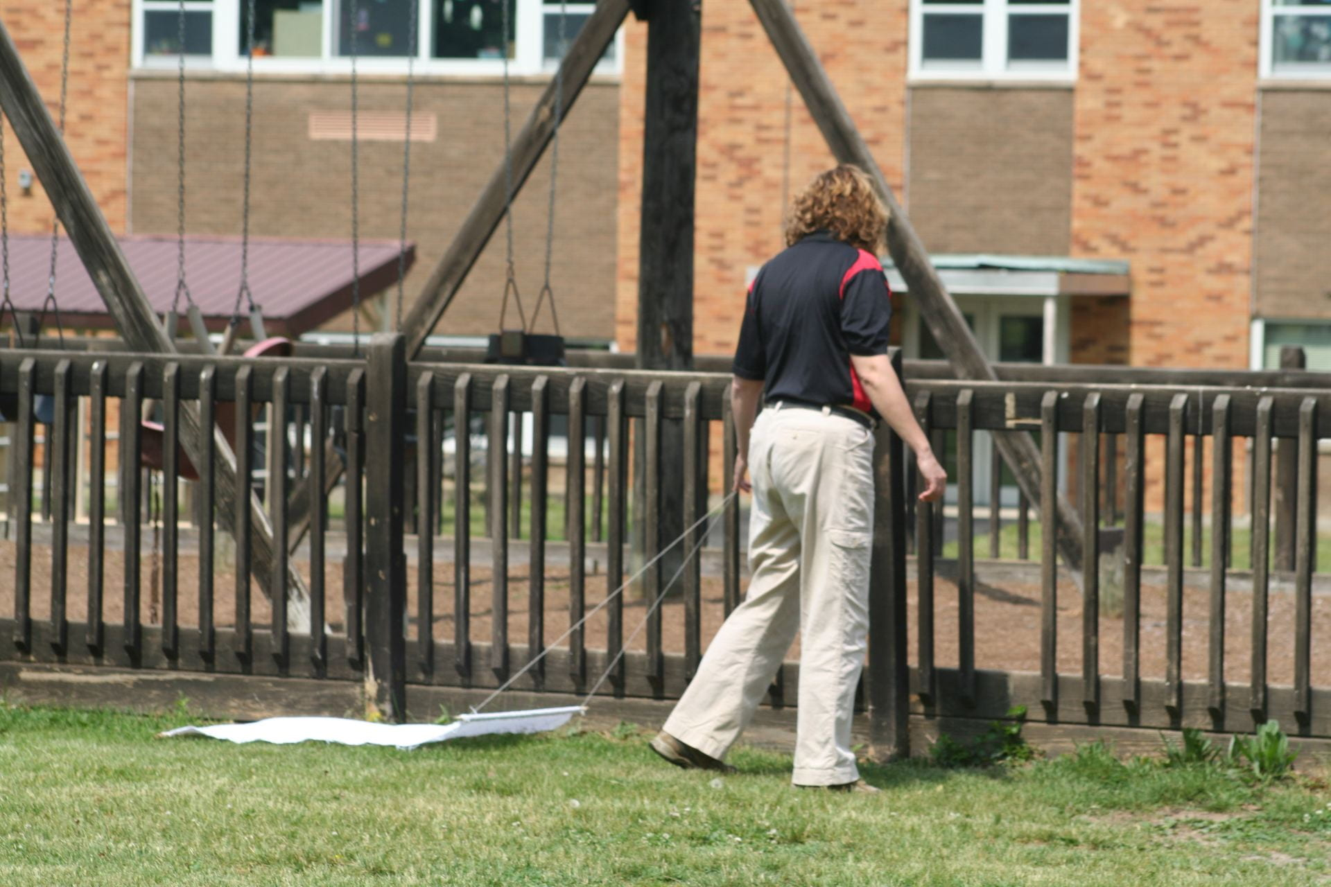 photo shows Joellen Lampman using a tick drag on school property to monitor for ticks