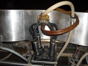 Milking machine with four suction cups.