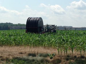 The massive reel that retracts the nutrient boom once it's detached from the tractor