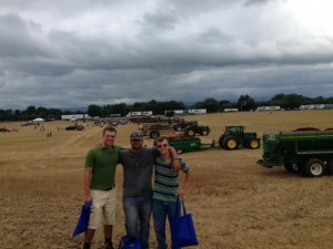 Hanging out at the North American Manure Expo with Isaac Cornell (left) and Andrew LeFever (right). Behind us are dry manure spreaders performing demonstrations for the large crowd of people (Spoiler alert for my next blog...)