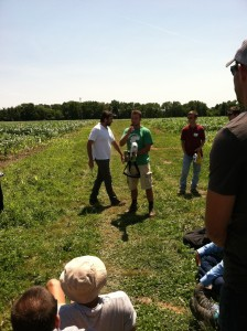 Fellow intern, Isaac, demonstrates how Greenseeker equipment functions in Field Z