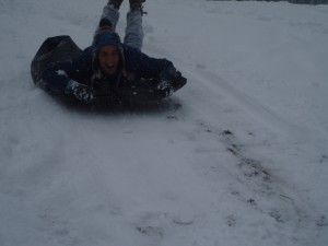 A friend of mine sledding on a garbage bag