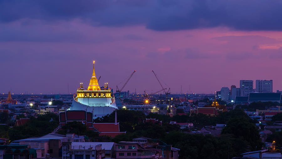 city skyline with a pink and purple sky