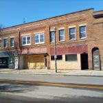 shuttered stores in a downtown area