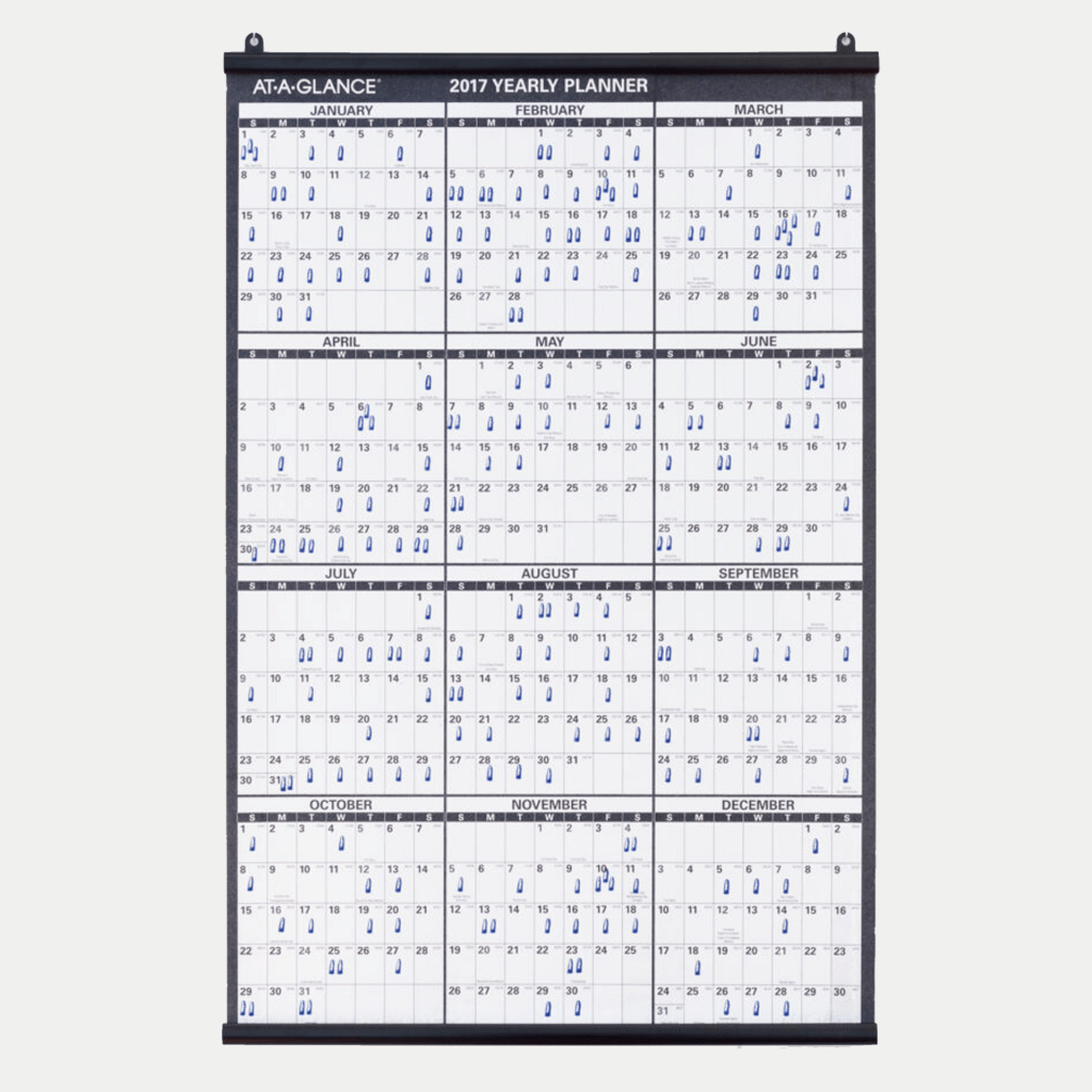 Image of calendar with blue icons on specific dates