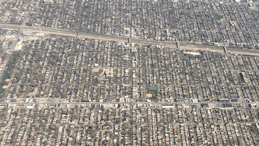 aerial view of neighborhood with houses and highways