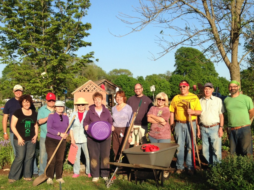 A happy tribe of MG Volunteers keeps the Children's Garden growing at Suffolk County Farm.