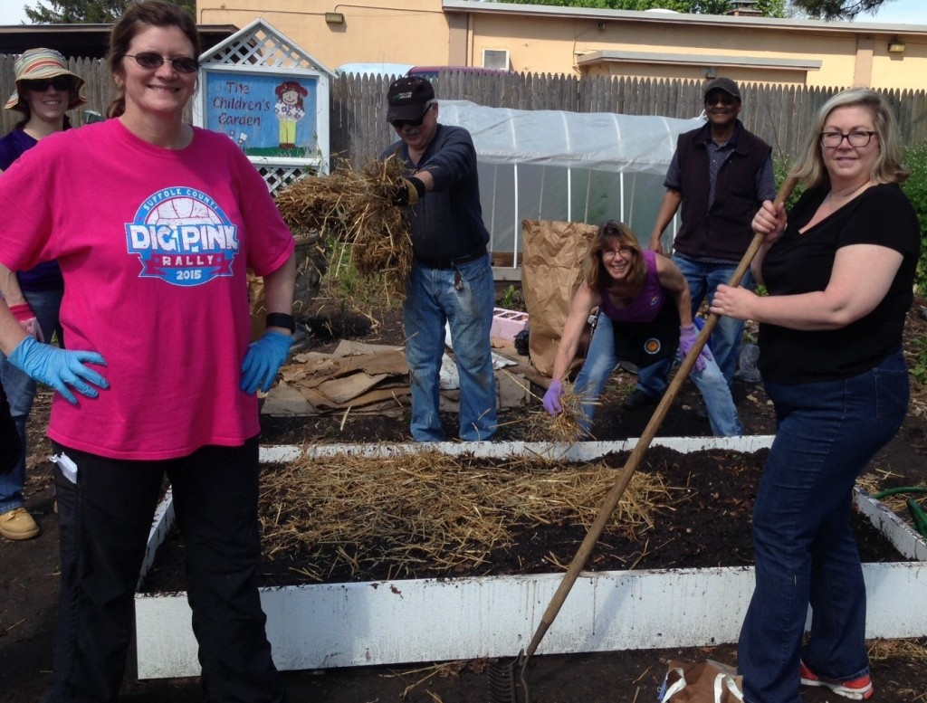 MG Volunteer trainees learned how to create healthy soil by sheet mulching into raised beds at the Children's Garden.