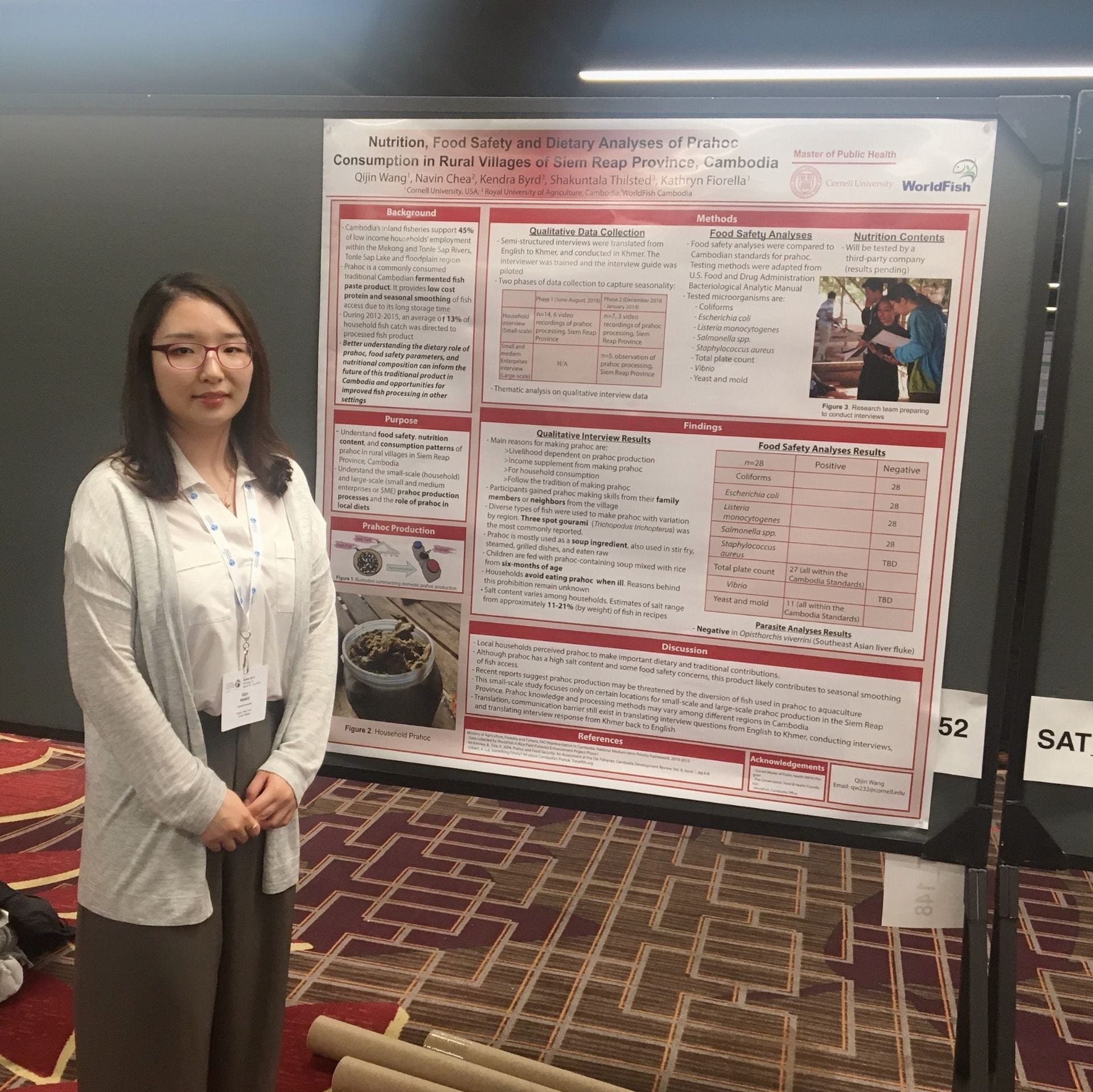 Qijin Wang with poster at Consortium of Universities for Global Health