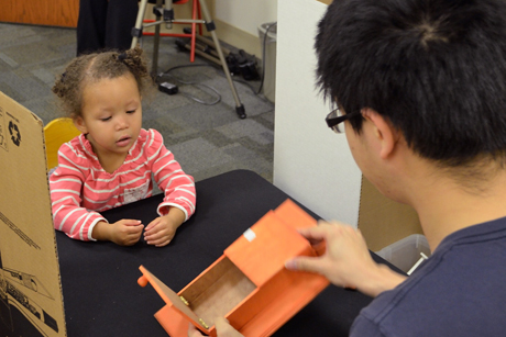 Graduate student Yue Yu conducts an imitation toy test in Jushnir's Early Chilhood Cognition Laboratory with Saffron Gold-Rodgers.