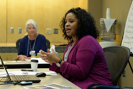 Tasha Lewis, assistant professor of fiber science and apparel design, presents her research priorities to the group. Photo by Mark Vorreuter