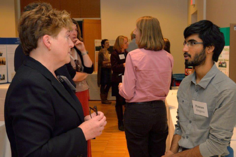 Pawan Angara discusses his spotted wing drosphila research with College of Agriculture and Life Sciences Dean Kathryn Boor. - Mark Vorreuter