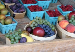 A picture of summer fruits on display at a farm market.