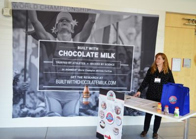 Dairy Coop table in front of banner 868-1290zlu