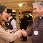 Alumni shaking hands
