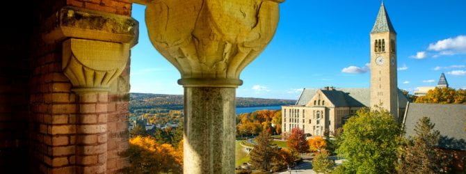Cornell University in the fall with McGraw Tower and Cayuga Lake.