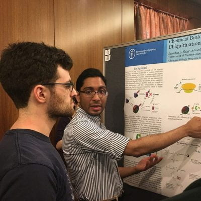 Jonathan Khan, presents his poster.