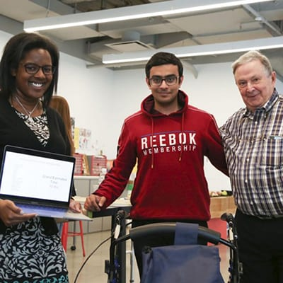 A Cornell Tech student and two older adults.