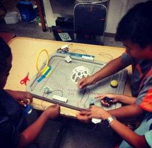 Children making a maker project
