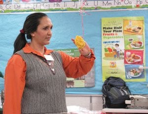 Teacher showing example about nutrition in classroom