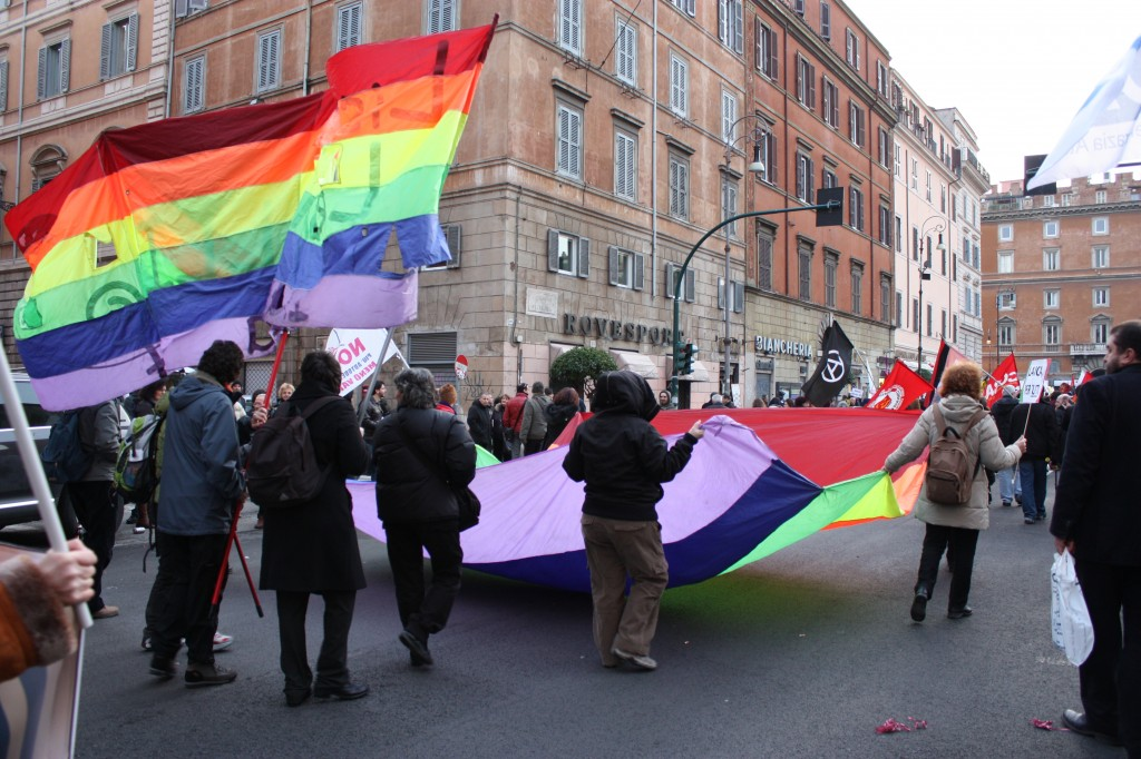 My new friend and others carrying the rainbow flag towards Largo Argentina.