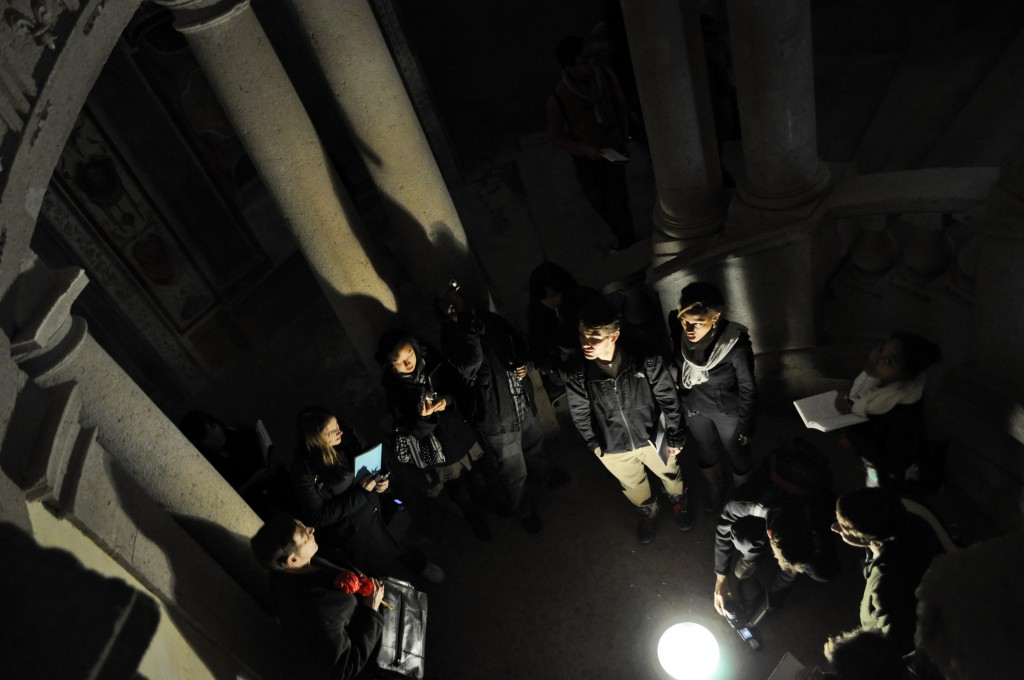Students at the base of the circular staircase