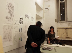 Dambruoso offers feedback as he wanders from desk to desk. Here, with Melody Stein, BFA 16'