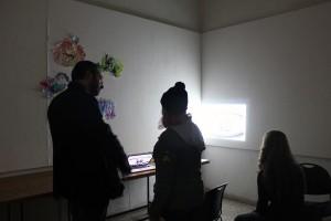 Dambruoso watches a video installation by Rachel Margolis, BFA 16'. Photo: Melody Stein