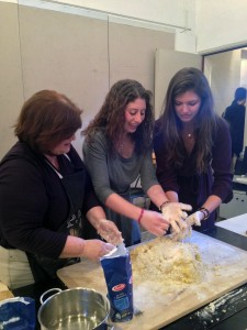 Anna Rita demonstrates how to prepare the dough for kneading