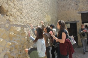 Urban Planning students inspect ancient stonework in Herculaneum.