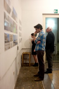 Visitors examine the work of the Intro to Photography class. Photo: Rina Kang
