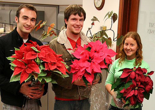 Members of Hortus Forum undergrad horticulture club deliver poinsettias to the Dean's office in Roberts Hall.