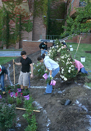 First-year plant science majors plant a garden outside of Fernow Hall.