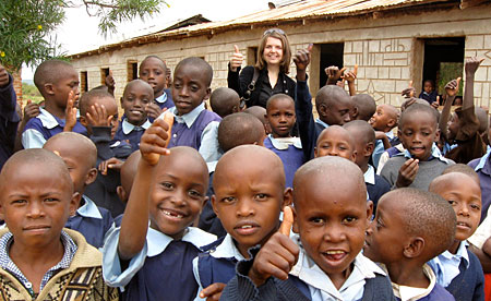 Caption:  Christine Hadekel with schoolchildren in Kitui, Kenya, summer 2010.