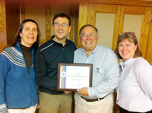 Rossi (second from left) accepts 'Excellence in IPM' award from NYSIPM Program staff on April 25.