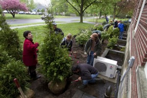 Nina Bassuk, left, oversees plantings in front of Hedrick Hall in Geneva as part of a final project by her Creating the Urban Eden class.  Photo by Rob Way.