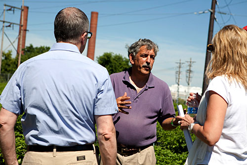 Marvin Pritts, Department of Horticulture chair, explains his high tunnel research at East Ithaca Research Farm to President David Skorton and Robin Davisson.