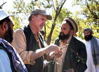 Ian Merwin working with Pashtun fruit growers in Afghanistan