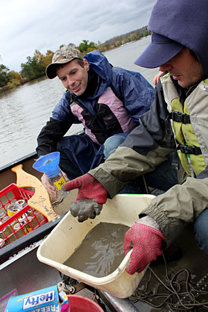 Students sample sediment in Cayuga Inlet.