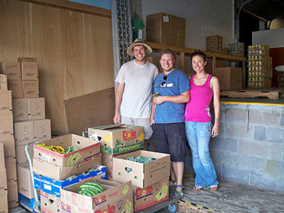 John Gottula, Benjamin Orcheski and Carly Summers of the Student Association of the Geneva Experiment Station deliver donations collected from their student garden and faculty research trials. Photo credit: Cheryl Toor/Geneva Center of Concern