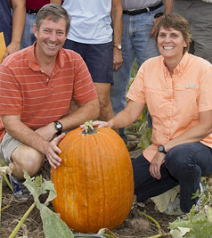 Larry and Christine Smart with their winning pumpkin.  Photo by Rob Way.