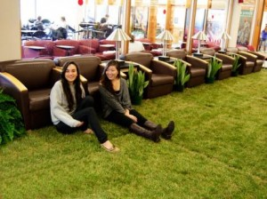Students lounge on the lawn in the lobby of Mann Library.