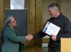 Abby Seaman presents Steve McKay with an Excellence in IPM award.