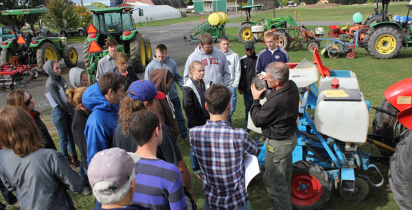McKay teaches vegetable production class about the inner workings of a planter.