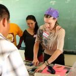Shoshana Mitchell '14 demonstrates how to make a garden journal during a Toledo District Teacher training.
