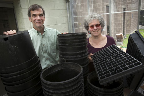 Nate Leonard, left, and Lois Levitan have helped New York farmers recycle more than 1 million pounds of plastic since 2011. (Jason Koski/University Photo)